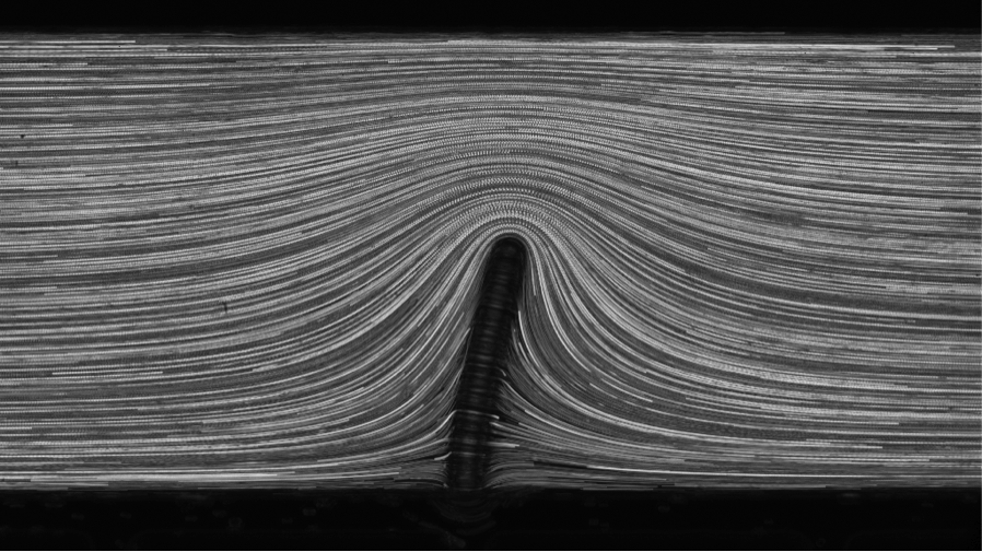 Bending of elastic fibers in viscous flow